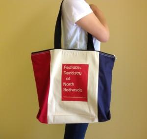 Large eco tote bag with Pediatric Dentistry at North Bethesda logo imprint.